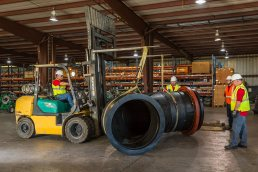 Transporting a large pipe at the Wolseyley Industrial Group, Industrial photography Lakeland, Florida by Tampa based commercial photographer Carver Mostardi.
