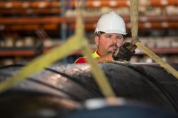 Loading a large pipe at the Wolseyley Industrial Group, Industrial photography Lakeland, Florida by Tampa based commercial photographer Carver Mostardi.
