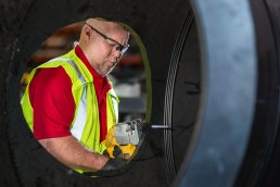 Working on the pipe at the Wolseyley Industrial Group, Industrial photography Lakeland, Florida by Tampa based commercial photographer Carver Mostardi.