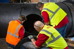 Assembling large HDPE piping section at the Wolseyley Industrial Group, Industrial photography Lakeland, Florida by Tampa based commercial photographer Carver Mostardi.
