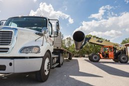 Loading a large pipe for shipment at the Wolseyley Industrial Group, Industrial photography Lakeland, Florida by Tampa based commercial photographer Carver Mostardi.