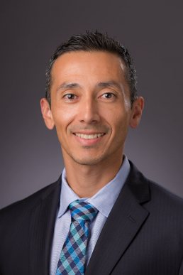 Professional corporate headshot of male executive with gray background from SCS Engineers in Tampa, Florida.