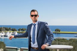 Professional portrait of male executive outdoors overlooking the harbor in St. Petersburg, Florida.