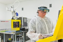 Technician inspecting production at plastics manufacturing facility in Brooksville, Florida by industrial photographer Carver Mostardi.