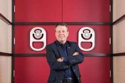 Cott Corporation CEO Jerry Fowden photographed with large red doors at corporate headquarters Tampa, Florida.