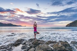 Woman doing sunset yoga in Playa del Coco, Costa Rica by Tampa commercial photographer Carver Mostardi.