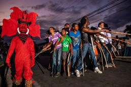 Red Devils frighten children during Carnival in Bocas del Toro, Panama.
