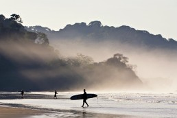 Sunrise surfing in Dominical, Costa Rica.
