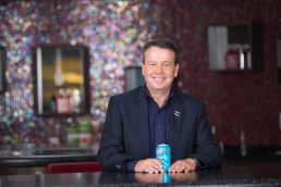 Cott Beverages CEO Jerry Fowden sitting with soft drink - Carver Mostardi Photography - Tampa corporate portraits.