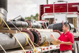 Counting pipes before shipping at The Wolseyley Industrial Group, Industrial photography Lakeland, Florida by Tampa based commercial photographer Carver Mostardi.