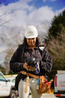 Florida construction photographer Carver Mostardi captures female service technician working in the field with handheld device.