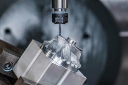 Close up photo of Cnc machine milling gear at Seaway Plastics manufacturing in Port Richey, Florida.