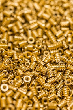 Close up product photo of brass metal parts manufactured by Florida manufacturing photographer Carver Mostardi.