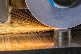 Photo by Tampa industrial photographer Carver Mostardi of sparks flying off of sanding machine at manufacturing facility in Central Florida.