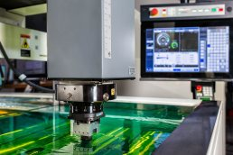 Industrial product photo of Makino CNC electrical discharge machine by Tampa industrial photographer Carver Mostardi.