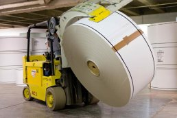 Forklift carry paper roll at Paperworks Industries Wabash, Indiana. Carver Mostardi industrial photography Tampa, FL.