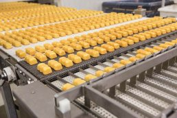 Industrial photography of Tastykake Butterscotch Krimpets on food production line by Tampa commercial photographer Carver Mostardi.