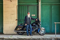 Portrait of Kent Davis, President Kingdom First Holding with motorcycle in Ybor City, Tampa, Florida.